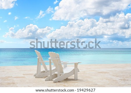 Beach chairs facing the ocean stock photo 19429627 shutterstock