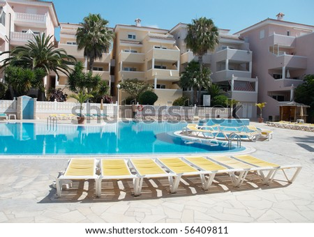 Beach chairs near the swimming pool of luxury hotel. Tenerife, Canary Islands, Spain.