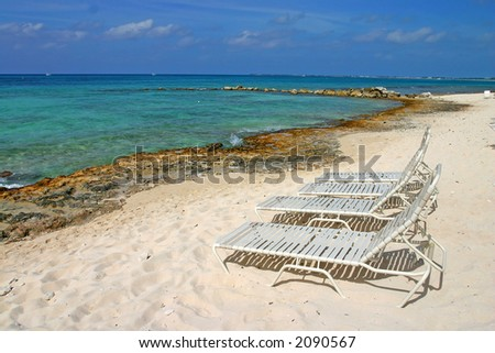 Beach chairs on Seven Miles Beach