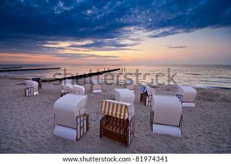 Beach chairs on shore of the Baltic Sea.