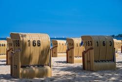 Beach chairs on the fine sandy beach of Möltenort on the Kiel Fjord in summer