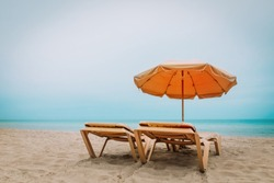 Beach chairs on tropical vacation, travel to sea concept