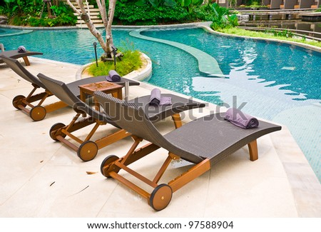 Beach chairs side swimming pool at Thailand