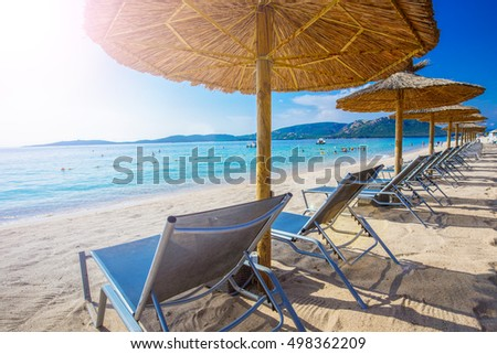 Beach chairs with a white sandy beach in Corsica, France, Europe  #498362209