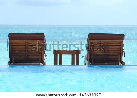 Beach chairs with swimming pool near the sea