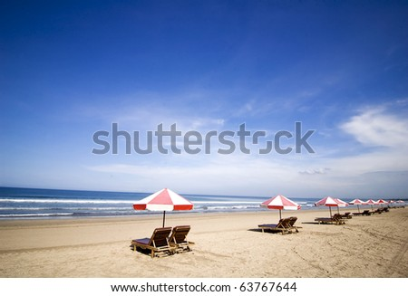 Beach chairs with umbrella on beautiful island