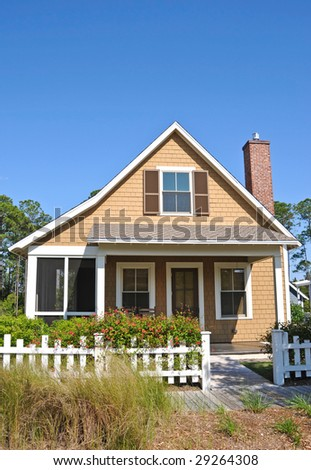 Beach Cottage with a White Fence