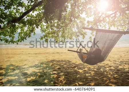 beach cradle under the tree by the beach. Freedom concept #640764091