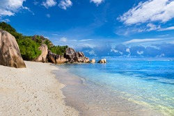 Beach destination for summer vacation holidays, Anse Source d'Argent in La Digue Seychelles. Paradise tropical island in Indian ocean with pristine white sand, turquoise sea water and granite rocks.