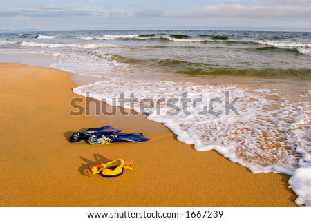 Beach.Evening. In the foreground equipment for a scuba diving.