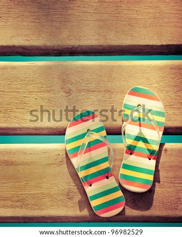 Beach flip flops on wood. Summer vacations background