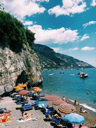 Beach goers flock to the warm beaches of the Mediterranean on the Amalfi Coast