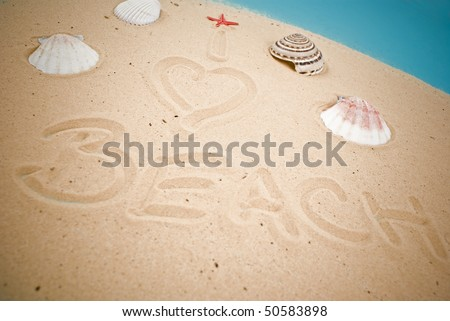 Beach handwritten in sand
