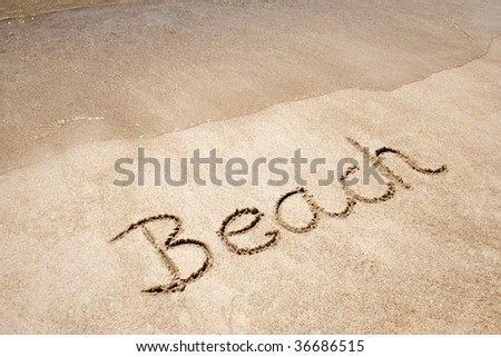 beach handwritten in sand on a beach with a nice wave #36686515