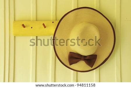 Beach hat hang on the wood wall background