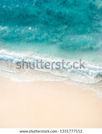 Beach holidays pictures Drone views of beach, waves, surf, swimmer, sea, ocean in Australia. Beautiful aerial of coastal images. - Image