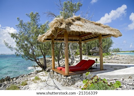 Beach hut on beautiful small and rocky tropical island.