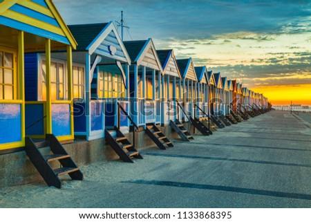 Beach huts at Southwold, Suffolk, England, at sunrise.