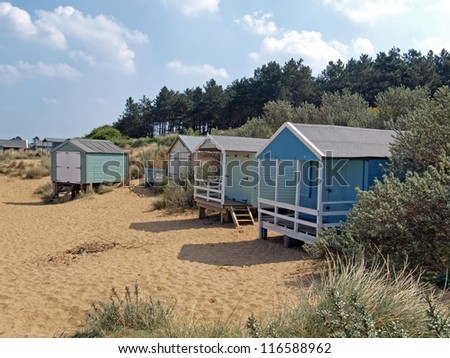Beach huts in the sand dunes on the North Norfolk beach.