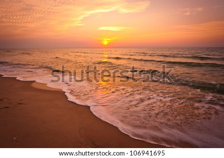 Beach in Cha-am, Thailand. Shoot in the morning with amazing sunrise sky.