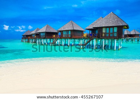 beach in Maldives with few palm trees and blue lagoon #455267107