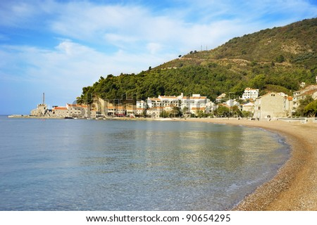 Beach in Petrovac city in the sunshine day. Montenegro