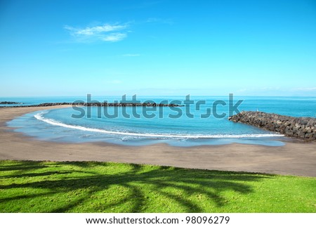 Beach in popular tourist destination of Playa de las Americas, Tenerife
