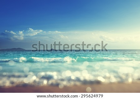 Shutterstock beach in sunset time, tilt shift soft effect