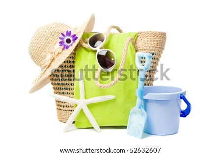 Beach items including bucket and spade on white background