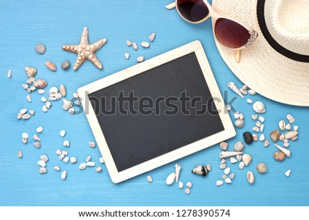 Beach items with straw hatl and sunglasses  on wooden background. Vacation and travel items, top view Stok fotoğraf ©