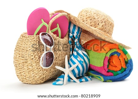 Beach items with swimming suit,towel,flip flops and sunglasses.Isolated on white background.