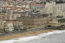 Beach landscape France: The ancient seaside resort architecture of Biarritz with its Belle Époque ritzy charme and glamourous vibe along the Grand Plage at stormy weather