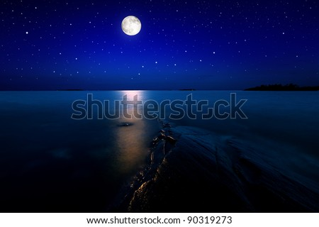 Beach landscape in moon light with stars on the sky stock photo