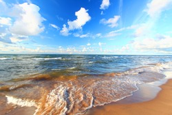 Beach landscape of waves crashing along the shores of Lake Superior in Michigan