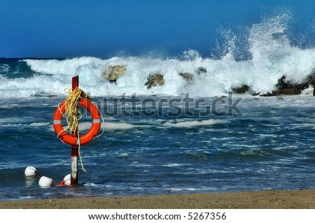 Beach life saver with rough sea and big waves in the background