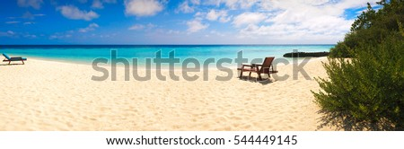 Beach lounger on sand beach. Web banner tropical beach panorama background. Vacation holiday  concept background wallpaper.