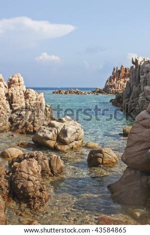 Beach made mostly of rocks in Calarossa, Sardinia, Italy