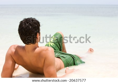 beach man relaxing by the beach while on vacation