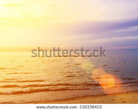 Beach natural background blur warm colors and bright sun light summer background. World Ocean Day. #530338453