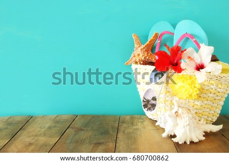 Beach objects on wooden table. Summer beach vacation concept. #680700862