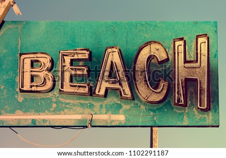 BEACH old vintage sign or rusty iron signage