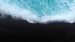 Beach on aerial drone top view with ocean waves reaching shore, top view aerial photo from flying drone of an amazingly beautiful sea landscape. New Zealand.