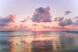 Beach on dusk with pink sanset sky