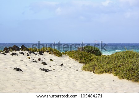 Beach on Lanzarote, Spain - Beach of white sands holds a beautiful view of the Atlantic ocean, near Orzola, North of Lanzarote, Spain.