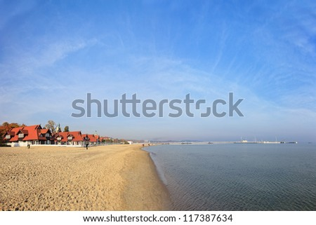 Beach on the background of the pier in Sopot, Poland.