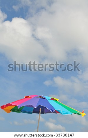 beach parasol over the blue sky background