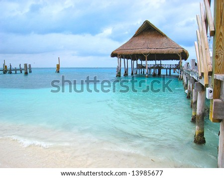 beach pier and palapa hut on dock