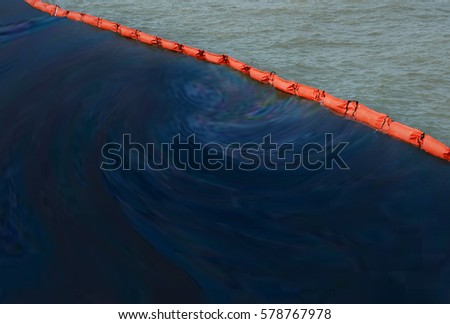 Beach pollution concept  .  A containment boom is a temporary floating barrier used to contain an oil spill. Booms are used to reduce the possibility of polluting shorelines and other resources. stock photo