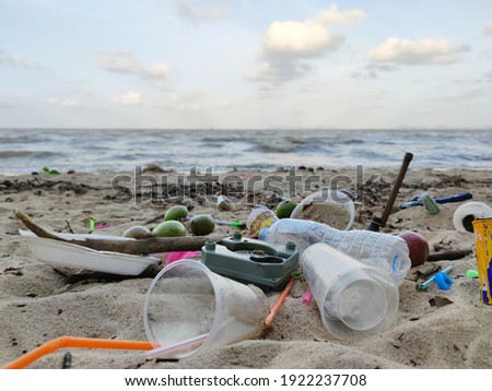 Beach pollution. Plastic bottles and other trash on sea beach. Ecological concept. earth day concept.globe pollution. Garbage on beach. Plastic at the ocean.