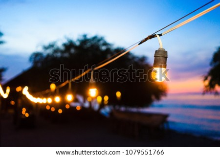 Beach promenade at sunset with party lights